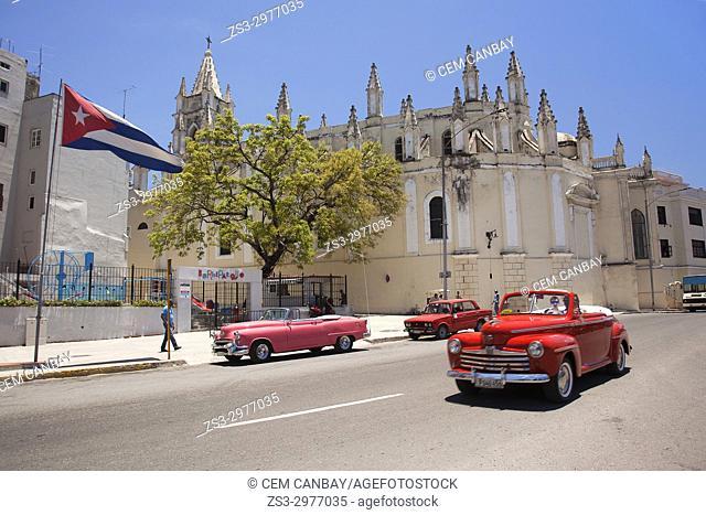 Old American cars in front of the Saint Angel Custodio Church-Iglesia del Santo Angel Custodio at Old Havana-Havana Vieja district, La Habana, Cuba, West Indies
