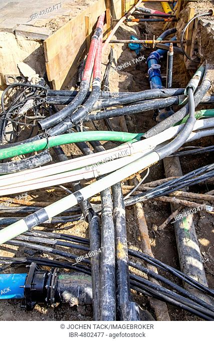 Cables, pipelines, tangle in a construction site, supply lines exposed during construction work, Friedrichstraße in Düsseldorf, Düsseldorf