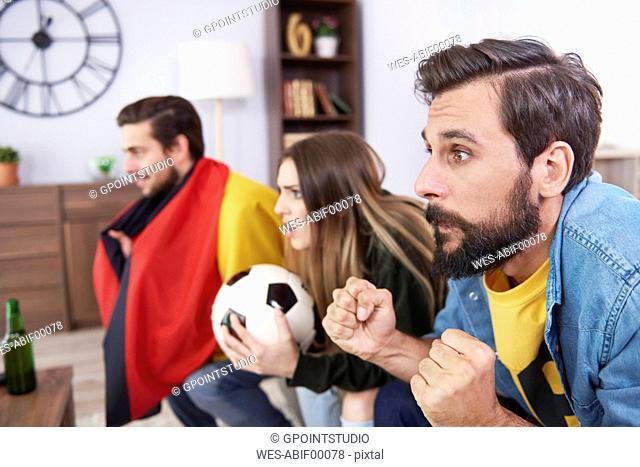 Worried German football fans watching Tv