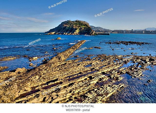 View of low tide in the Bay of San Sebastian, with the island of Santa Clara  Guipúzcoa, Basque Country, Spain