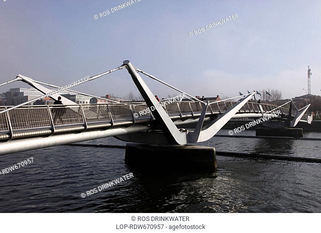 Republic of Ireland, Dublin, Dublin, The Millennium Bridge, a pedestrian bridge over the River Liffey connecting Temple Bar to the North Quays in Dublin