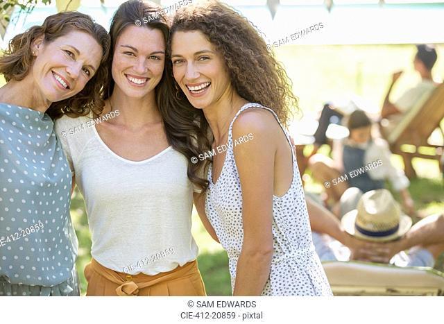 Family hugging at family picnic