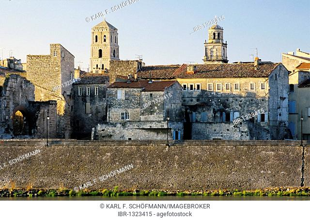 Medieval buildings and city gate on the banks of the Rhone River, Arles, Bouches-du-Rhone, Provence-Alpes-Cote d'Azur, Southern France, France, Europe
