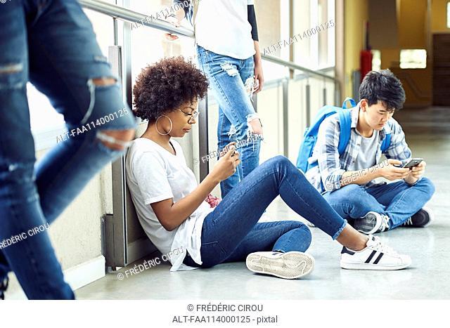 Students killing time in corridor between classes