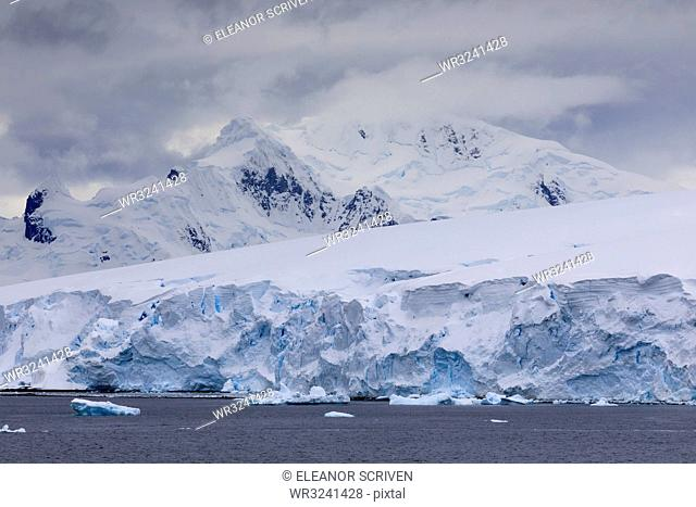 Low lying clouds over the mountains and blue glaciers of Paradise Bay, Antarctic Peninsula, Antarctica, Polar Regions