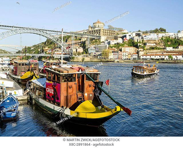 View towards Vila Nova de Gaia on the opposite side of river Douro, where most port wine cellars are located. City Porto (Oporto) at Rio Douro in the north of...