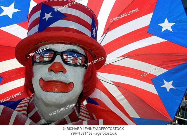 A clown marches in the 13th Annual National Puerto Rican Day Parade in New York on Fifth Avenue