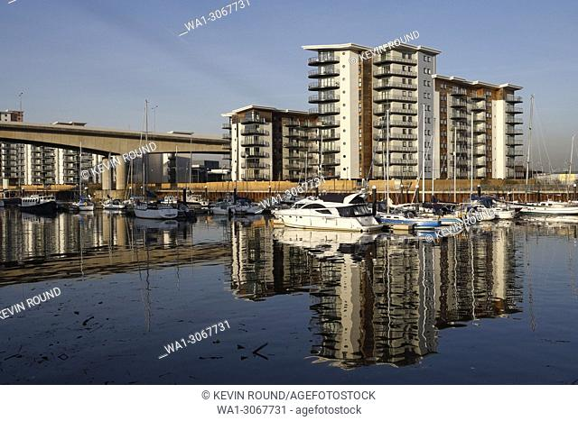 River Ely in Cardiff Bay Wales UK, with modern riverside apartments alongside