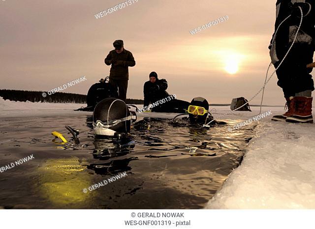 Russia, Arctic Circle Dive Centre, polar circle, ice divers at hole