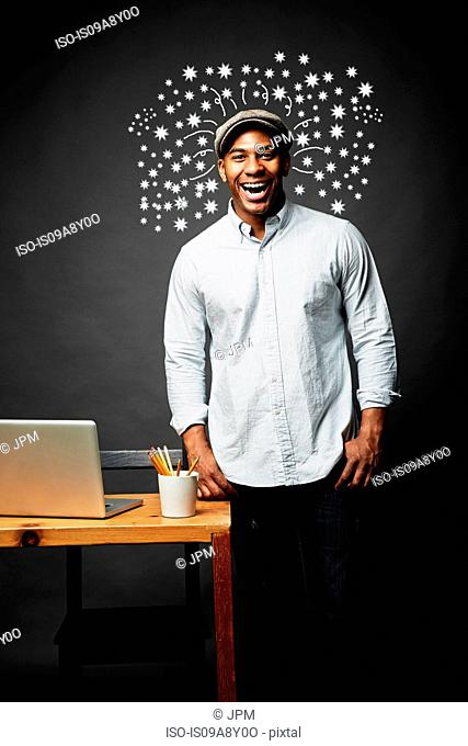 Laughing man bursting with great ideas