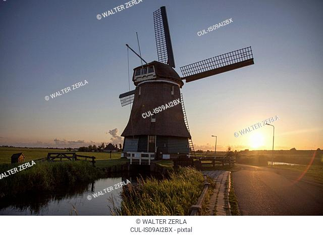 Windmill and waterway at sunset, Vollendam, Netherlands