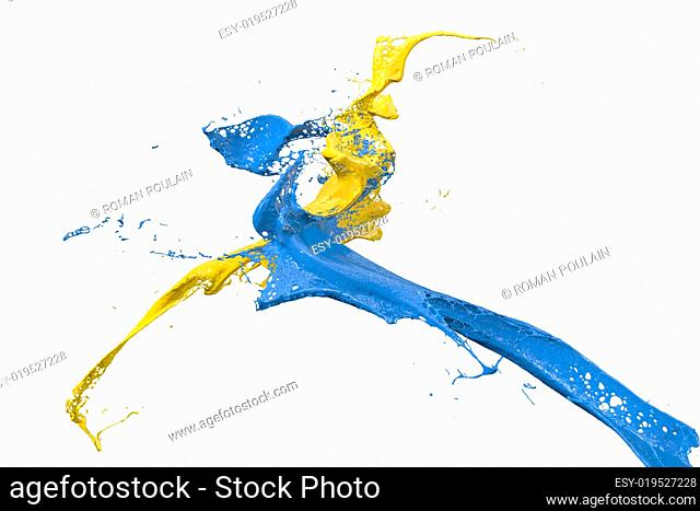 splashing paint in yellow and blue