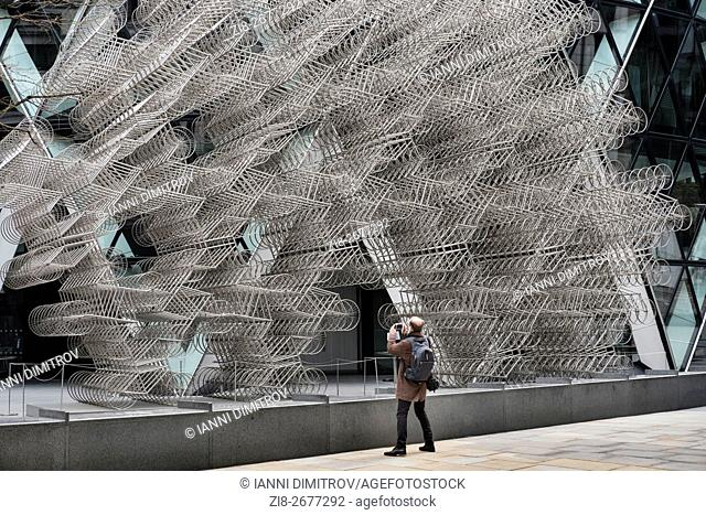 """ourist photographing Ai Weiwei's sculpture """"""""FOREVER"""""""" intalled outside the Gherkin,City of London,England"""