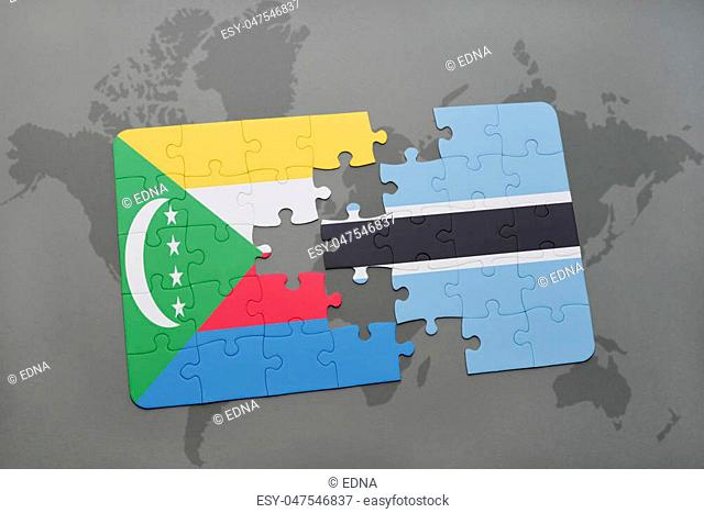 puzzle with the national flag of comoros and botswana on a world map background. 3D illustration