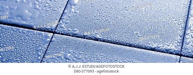 Water drops on blue tiles