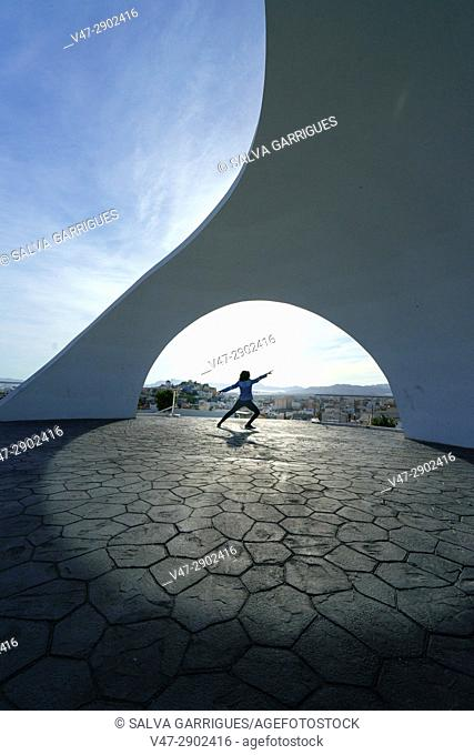 Woman dancing at Viewpoint of La Calica de Aguilas, Murcia, Spain