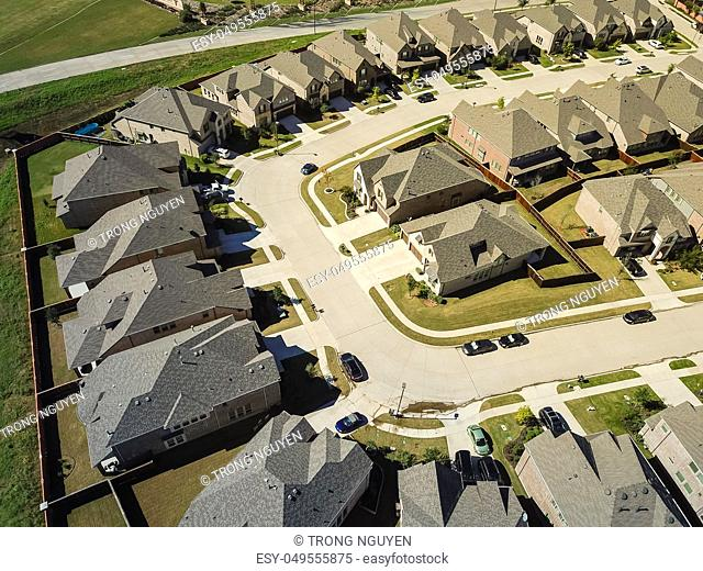 Aerial view new development community with row of detached single-family house and garden. Flyover residential area suburban Dallas, Texas, USA