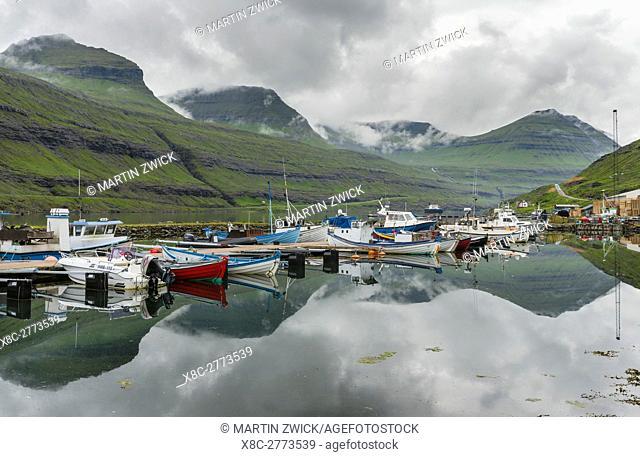 Village Funningsfjordur. The island Eysturoy one of the two large islands of the Faroe Islands in the North Atlantic. Europe, Northern Europe, Denmark