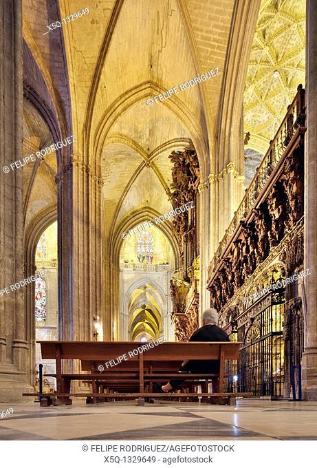Old lady sitting on a bench, Santa Maria de la Sede Cathedral, Seville, Spain
