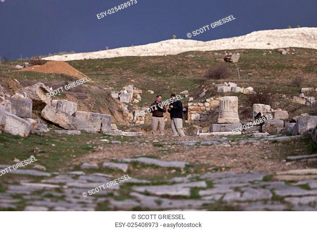 Male American tourists at the ruins of the Antioch Pisidian