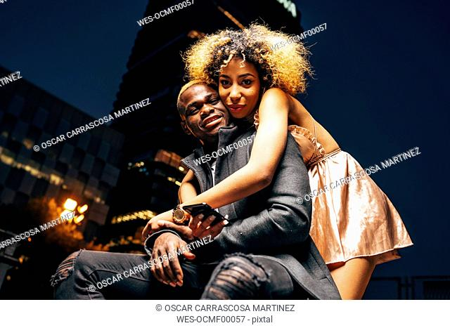Portrait of young couple in love at night in the city
