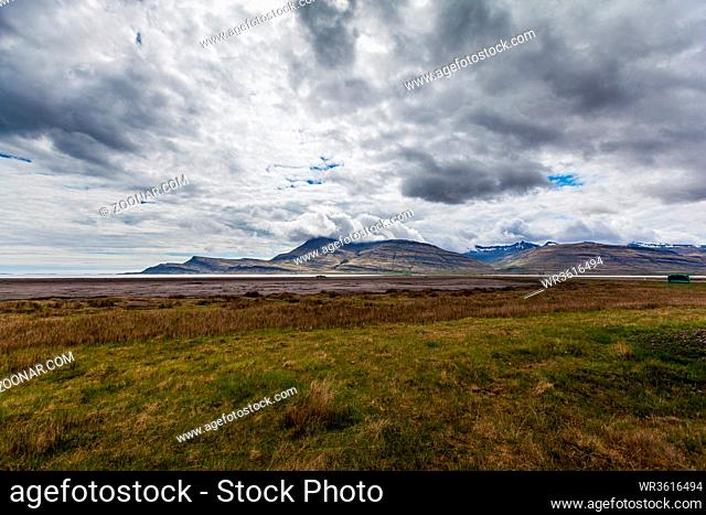 plain and mountains of o fjord with an overcast sky on Iceland
