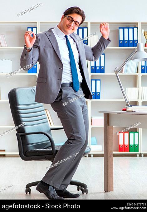 Businessman having fun taking a break in the office at work