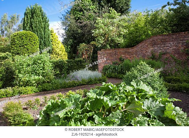 View of the walled kitchen garden in summer, Bexon Manor Kent England