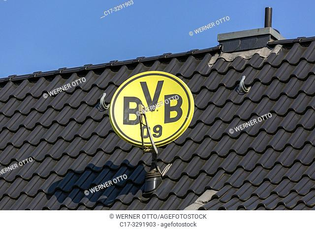 Bottrop, symbolic image, parabolic antenna in club colours and with club emblem of the German football club BVB 09 Borussia Dortmund on a house roof