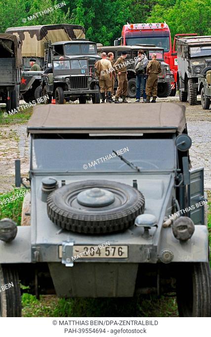 Extras stand on a parking lot in Osterwieck, Germany, 16 May 2013. Amercan actor George Clooney is filming his movie'The Monuments Men' in Osterwieck at the...