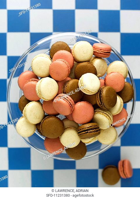 Lots of different macaroons in a glass bowl