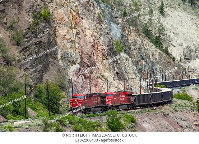 Canada, BC, Lyton. CP Rail train carrying coal in Thompson River canyon half way between Spences Bridge and Lyton. Viewed from Hwy 1