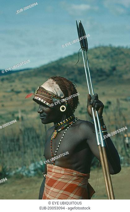 Threequarter portrait of Masai Moran warrior holding spear