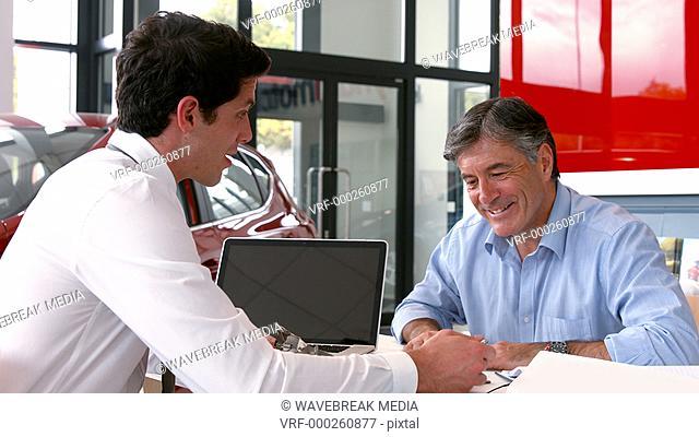 Businessman explaining the car details