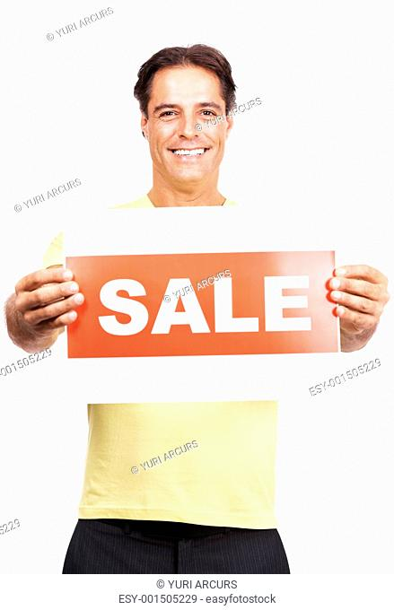 Portrait of a handsome smart man holding a sale sign board isolated against white background