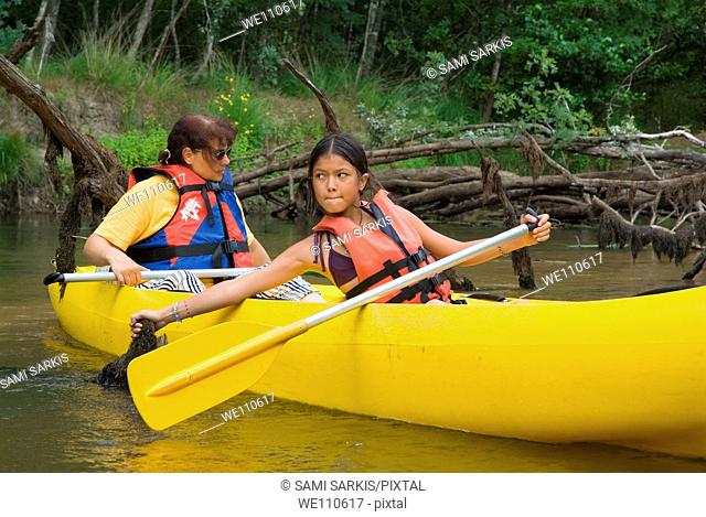 Mother and her daughter canoeing on the Eyre river, Aquitaine, France