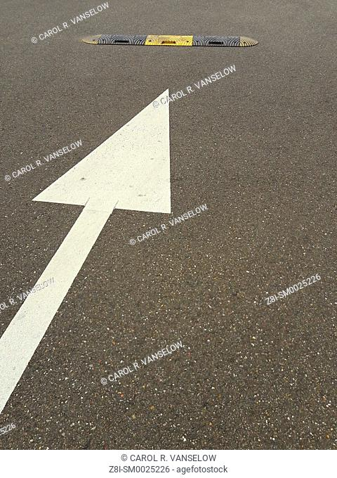 Look out for the speed bump. Bump is located in a parking lot of a supermarket