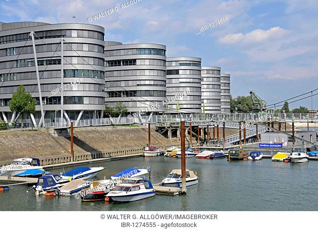 Five Boats office building and the first height-adjustable suspension bridge in the world, Inner Harbour, Duisburg, North Rhine-Westphalia, Germany, Europe