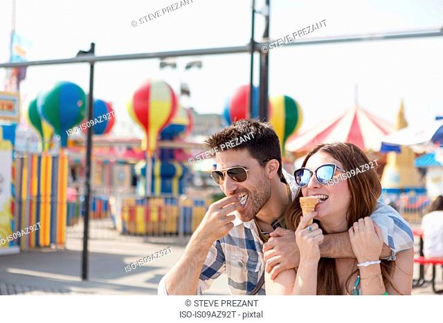 Couple eating ice cream cones, Coney island, Brooklyn, New York, USA