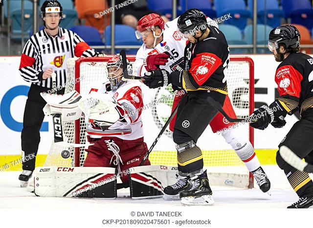 From left hockey players BRANDON MAXWELL, FILIP PAVLIK, both of Mountfield and KEVIN DUSSEAU, JORIS BEDIN both of Rouen in action during the Ice hockey...