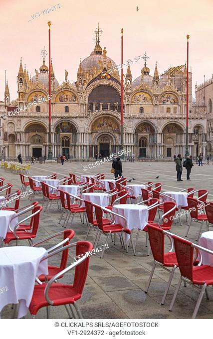 Europe, Italy, Veneto, Venice. Rows of chairs and tables at the outdoor cafe in St. Mark square