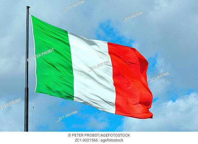 Italian national flag before the Railway station in Florence - Italy