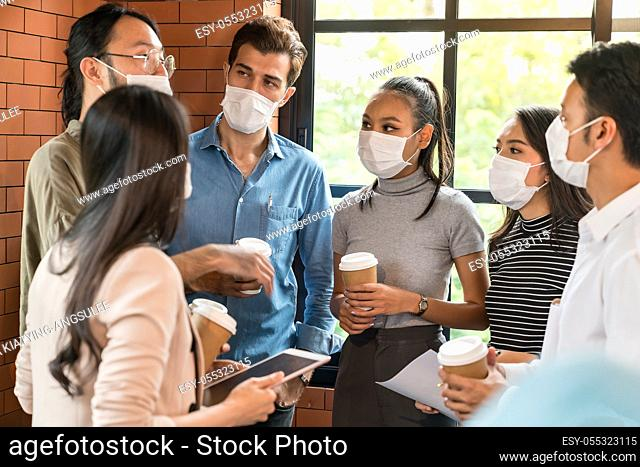 Group of business worker team meeting and brainstorm for startup new business. They wear protective face mask in new normal office preventing coronavirus...