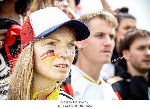 German football supporter watching attentively at match