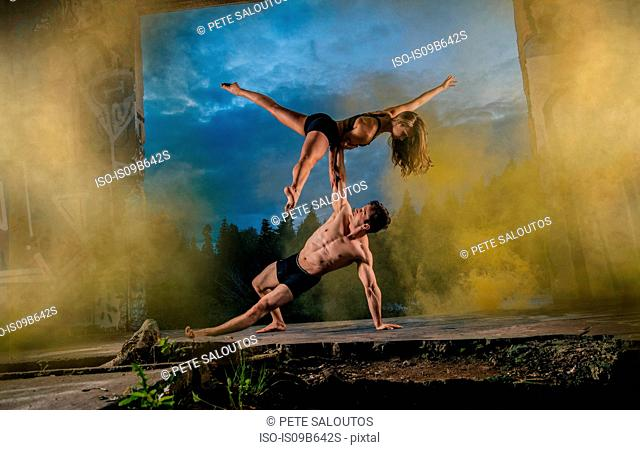 Acrobats performing on outdoor stage, Bainbridge, Washington, USA