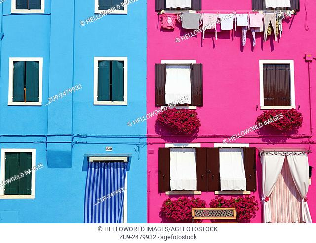Facades of two typical brightly painted Burano houses, Venetian Lagoon, Veneto, Italy, Europe