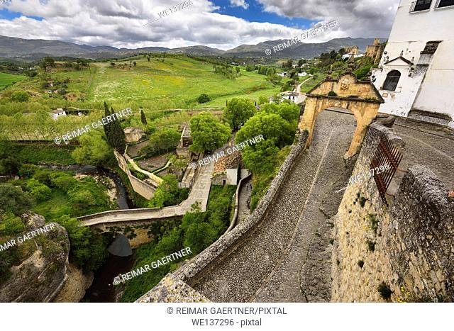 Arch of Felipe V with old Arab bridge and Arab Bath ruins in the city of Ronda Spain