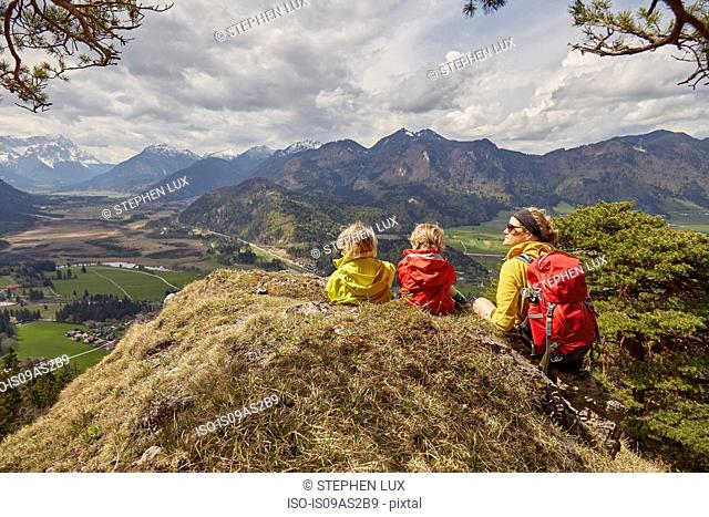 Mother and sons, looking at mountain view, Garmisch-Partenkirchen, Bavaria, Germany