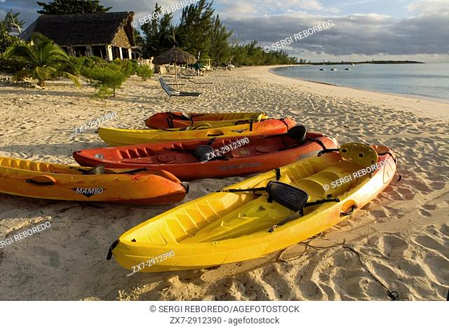 Kayaks and canoes. Beach of Fernandez Bay Village Hotel, Cat Island. Bahamas