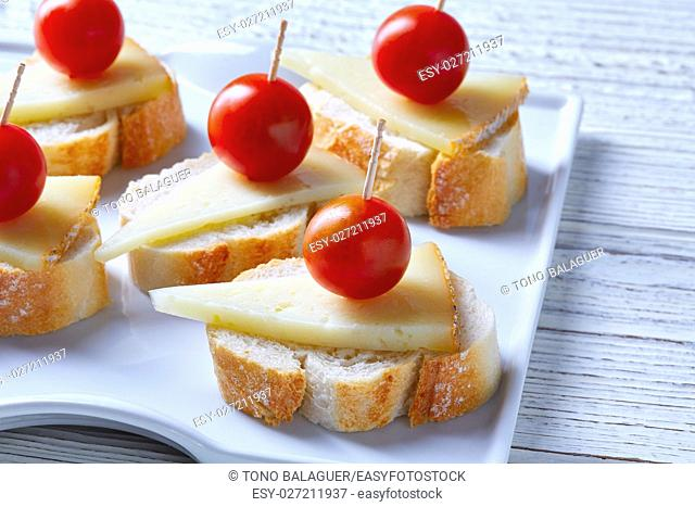 pinchos pintxos manchego cheese with cherry tomatoes from Spain